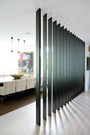 A Black Wooden Plank Screen Separates The Dining Room From Entryway And Living Flat Wall Design Space Dividers