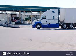 Long Haul Big Rig Semi Truck With Dry Van Trailer Going On Truck ...