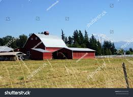 Red Barn Mount Rainier Background Near Stock Photo 685957828 ... Red Barn Washington Landscape Pictures Pinterest Barns Original Boeing Airplane Company Building Museum The The Manufacturing Plant Exterior Of A Red Barn In Palouse Farmland Spring Uniontown Ewan Area Usa Stock Photo Royalty And White Fence State Seattle Flight Interior Hip Roof Rural Pasture Land White Fence On Olympic Pensinula