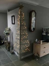 Clever Cute And Unique Corner Wall Christmas Tree Made From Wood Pallets Lights Smallspaces