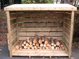 exterior minimalist outdoor log storage shed with all wood also