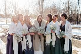 Bride Wearing A Warm Jacket And The Bridesmaids Wear Scarves For Cold Winter Wedding