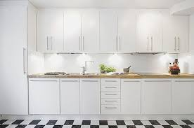 white kitchen cabinets with granite countertops brown wooden
