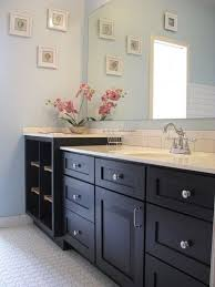 bathrooms with white cabinets and dark countertop light blue