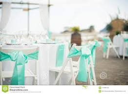 Stunning Blue Trim Decorates The Back Of These White Folding Chairs ...