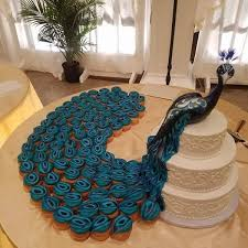 Creative Wedding Cake Peacock And Cupcakes