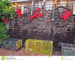 lobster crab and sea decorations on building with lobster traps