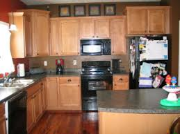 Kitchen With Maple Cabinets And Tiger Wood Floors