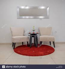 Two Chairs Stand On A Round Red Carpet Mat Above A Mirror ... Melltorp Teodores Table And 2 Chairs White Bright Orange Hgg Ding Set With Chairs Rubberwood Fniture Small Kitchen Extending And Dimeions Room Spaces For Tables Lpd Monroe High Gloss In Black Wine Barrel Bistro Two Stunning White Argos Ikea Ps 2012 Bamboo Saddle Brown 3piece Microfiber Latt Kids Chair X New Flat Interior Decorative Wall Effect Small Table Two Table2 Outdoor Askholmen Grey Greybrown Stained Brown