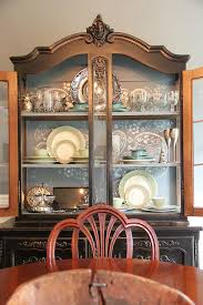 paint the inside of china hutch to light it but leave the outside