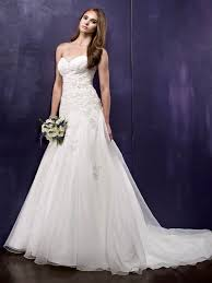 A Lovely Line Gown With Modified Sweetheart Neckline The Front Is Accented Pleated Pattern And Embroidery Back Features Buttons Cascading