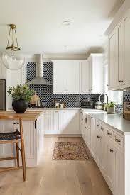 black backsplash tiles with white cabinets transitional kitchen