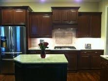 Kitchen Wall Paint Colors With Cherry Cabinets by Painting My Cherry Cabinets