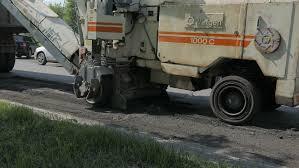 Road Asphalt Remain Dirt Load To Small Rv Bobcat Truck In Street