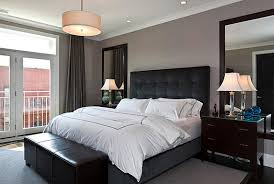 rectangle black leather headboard and grey white bed on grey rug