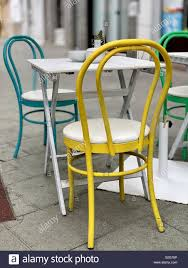 Yellow, Blue And Green Metal Chairs And White Table On The ... Lumisource Oregon High Back 5piece Vintage White And Aqua Small Farmhouse Table Set With Bench Metal 12ft Upcycled Board Table 12 Vintage Metal Chair Set 170 Wooden Hire Company Chairs Looking Restoration Painted Patio Fniture Modern Inspiring Chairs Stock Image Image Of Iron Old Fniture In Garden Natural Green Background Garden E6 Ldon For 8000 Sale Shpock Retro Porch Home Decor Ideas Find Great Outdoor Seating Folding Pastel Blue At Scaramanga