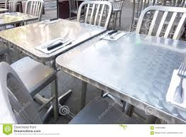 Stainless Steel Outdoor Restaurant Table And Chairs Stock Photo ... Home Source Donna Silver Metal Ding Table Grey Na Fniture Nice Chair Room Qarmazi White And Gray Set Of Eight Vintage Rams Head Angloindian Embossed Chairs Ausgezeichnet Industrial Wood Design Hefner Silver 5 Piece Ding Set 100 To Complete Flash 315 X 63 Rectangular Inoutdoor With 4 Stack Polk In Brushed Rustic Pine Seat 3pcs Black Metal Details About 2pcs Distressed 11922 Indian Hub Cosmo Silver Ding Table Chairs Thepizzaringcom