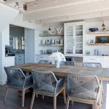 Example Of A Small Coastal Medium Tone Wood Floor And Gray Kitchen Dining Room