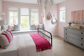 black metal bed with pink and gray bedding transitional bedroom