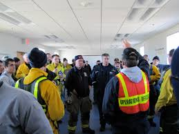An IMT Operations Section Chief addresses a group of firefighters at wildland fire exercise in Truro