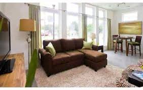 Dark Brown Sofa Living Room Ideas by Attractive Brown Couch Living Room With Color Curtains Go