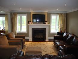 great room with windows flanking fireplace furniture placement