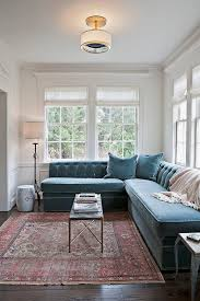 Transitional Living Room Leather Sofa by Currently Loving Roman Shades Transitional Living Rooms Blue