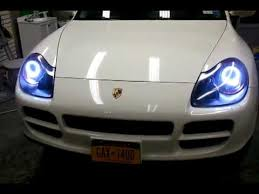 intothecar customized porsche cayenne s headlights