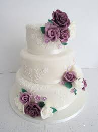 Beautiful White Lace Wedding Cake Decorations Combined With Lovely Purple Roses Flowers