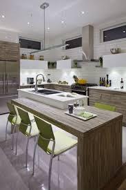 la cuisine d et armoires de cuisine de style contemporain l îlot et la totalité de