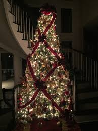Criss Cross Ribbon Wrapping On 10 Foot Christmas Tree