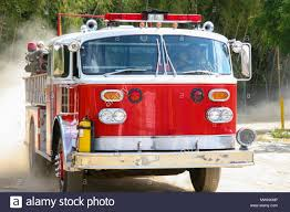 100 Red Fire Trucks A Shiny Truck In Action In Motion Stock Photo