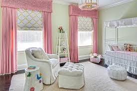 white canopy crib with pink bedding traditional nursery