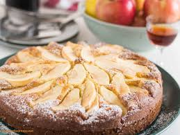 Side Shot Of Tuscan Apple Cake Showing The Apples On Top