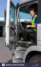 Truck Driver Sitting In Cab Of Semi-truck Stock Photo: 276999311 - Alamy Military Veteran Truck Driving Jobs Cypress Lines Inc Cattle Truck Driver Western Queensland Outback Australia Stock Portraits Of The American Driver Vice Description Salary And Education Should I Drive In A Team Or Solo United School Sitting Cab Semitruck Photo 276999311 Alamy Life As Woman Transport America Media Rources Usa Pay By Hour Youtube Tackling Australias Shortage Viva Energy Safety