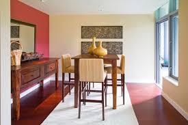 This Dining Room Features A Sharp Contrast Between Rich Hardwood Flooring Off White Walls