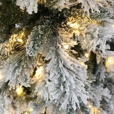 7ft Christmas Tree Uk by 7ft Slim Flocked Spruce Pre Lit Christmas Tree Amazon Co Uk