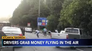 100 Two Men And A Truck Atlanta Rmoured Van Spills Thousands Of Dollars In Cash Across
