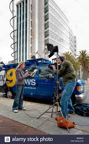 A Television News Reporter Makes An On Location Broadcast From Immigrants Rights Demonstration In Santa Ana CA Background