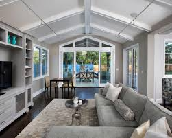 Lighting Solutions For Cathedral Ceilings by This Light Gray Family Room Features Dark Hardwood Floors And