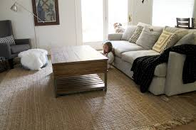 Natural Brown Lowes Area Rugs With Grey Sofa And Wooden Table For Living Room Decoration Ideas