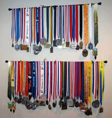 Use A Curtain Rod To Display Running Medals This Is Cool It Could Be Used