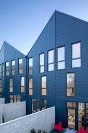 100 Townhouse Facades Waechter Architecture Completes Origami Townhouses With