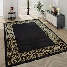 wohnzimmer teppich goldene bordüre schwarz