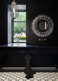 black powder room with white and black porcupine mirror