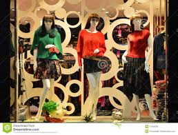 Store Display Window Light And Decorative Bike Fashion Boutique With Mannequins Sale Front Of Shop Royalty Free Stock Photo