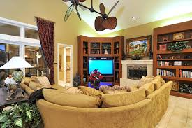 Rustic Ceiling Fan Family Room Tropical With Bookcase Bookshelves Image By Bella Luna Services Inc