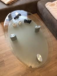 wohnzimmer glastisch oval mit ablage