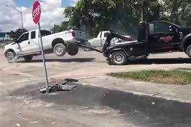 Repossessed Pickup Has Tug-Of-War With Tow Truck