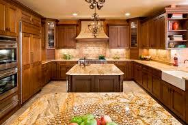 kashmir gold granite kitchen mediterranean with glazed cabinets